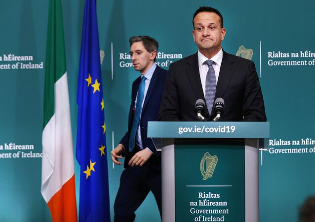Ireland's Prime Minister Taoiseach Leo Varadkar and Health Minister Simon Harris attend a news conference on the ongoing situation with the coronavirus disease (COVID-19) at Government Buildings in Dublin, Ireland March 24, 2020.