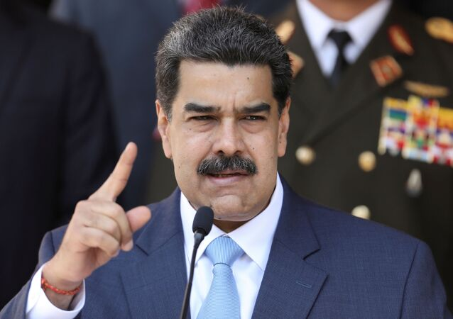 Venezuela's President Nicolas Maduro speaks during a news conference at Miraflores Palace in Caracas, Venezuela, March 12, 2020.