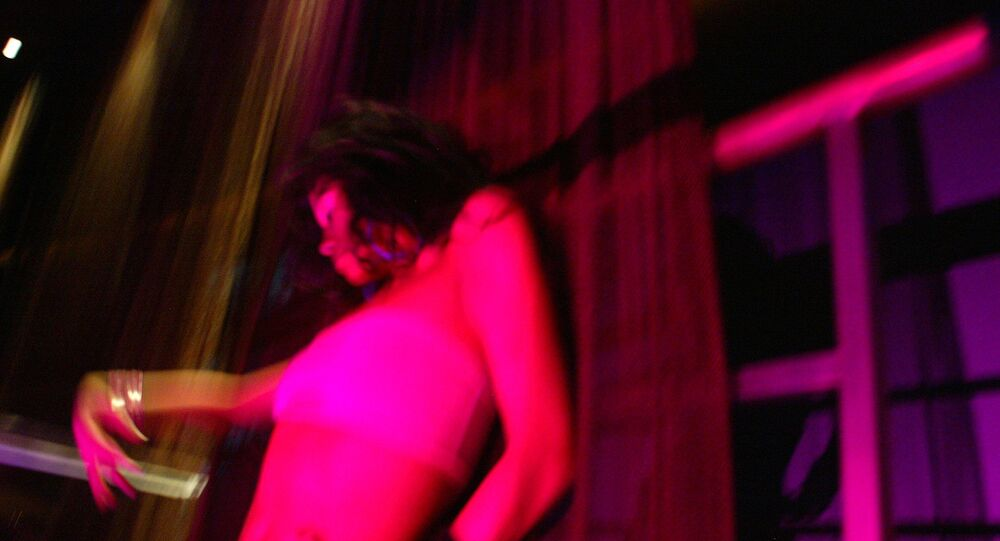 A go-go dancer performs at a club in New York June 15, 2005
