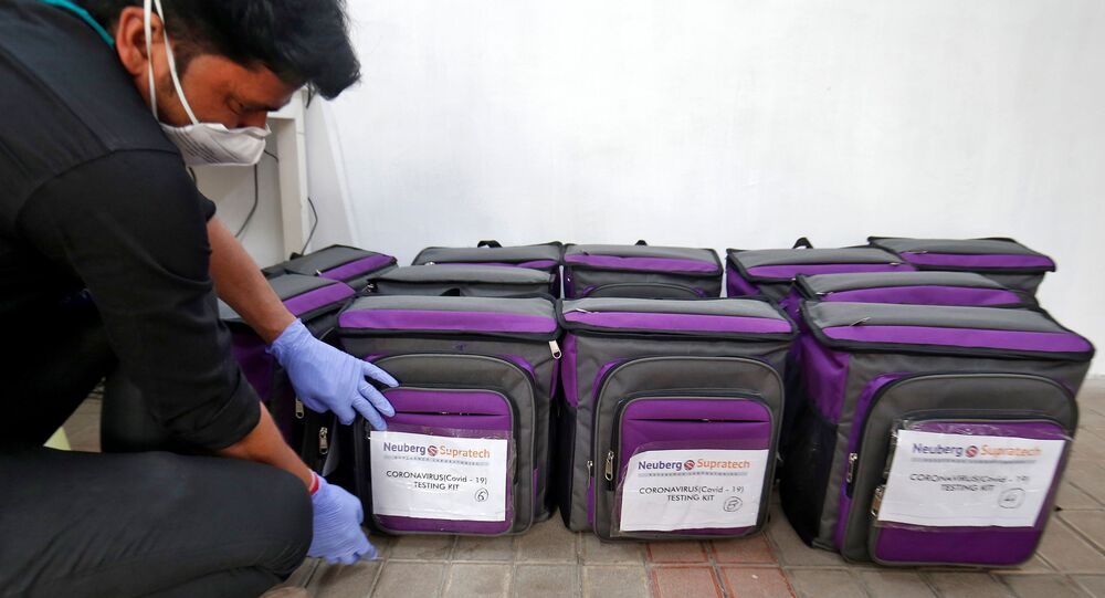 A laboratory technician places a tag on a box containing coronavirus disease (COVID-19) testing kit at a sample collection centre in Ahmedabad, India March 26, 2020.