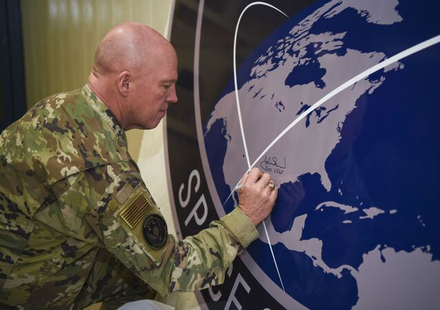 General John Raymond, U.S. Space Force chief of space operations, signs the United States Space Command sign inside of the Perimeter Acquisition Radar building Jan. 10, 2020, on Cavalier Air Force Station, North Dakota.