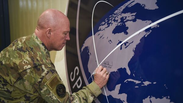 General John Raymond, U.S. Space Force chief of space operations, signs the United States Space Command sign inside of the Perimeter Acquisition Radar building Jan. 10, 2020, on Cavalier Air Force Station, North Dakota.  - Sputnik International