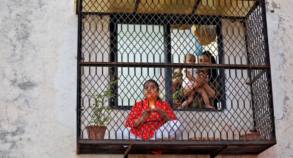 Hindu devotees pray for the eradication of coronavirus during Chaitra Navratri amid a nationwide lockdown to limit the spreading of the virus