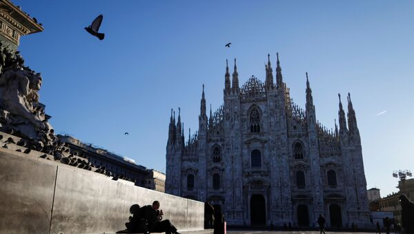 People walk through a near-empty Duomo square, usually full of people, as a coronavirus outbreak in northern Italy continues to grow, in Milan, Italy February 28, 2020. - Sputnik International