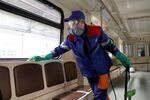 A worker cleans and disinfects a metro train as the spread of the coronavirus disease (COVID-19) continues, in Moscow, Russia March 25, 2020.