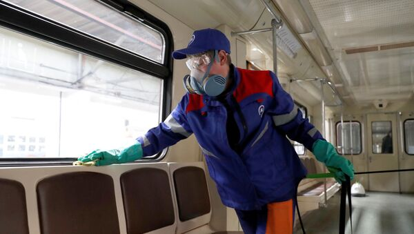 A worker cleans and disinfects a metro train as the spread of the coronavirus disease (COVID-19) continues, in Moscow, Russia March 25, 2020. - Sputnik International
