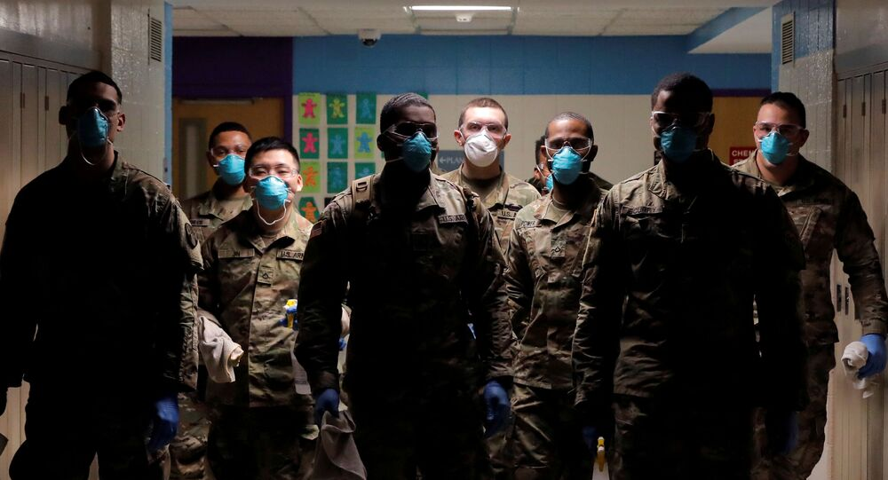 Members of Joint Task Force 2, composed of soldiers and airmen from the New York Army and Air National Guard, work to sanitize the New Rochelle High School during the coronavirus disease (COVID-19) outbreak in New Rochelle, New York, U.S., March 21, 2020