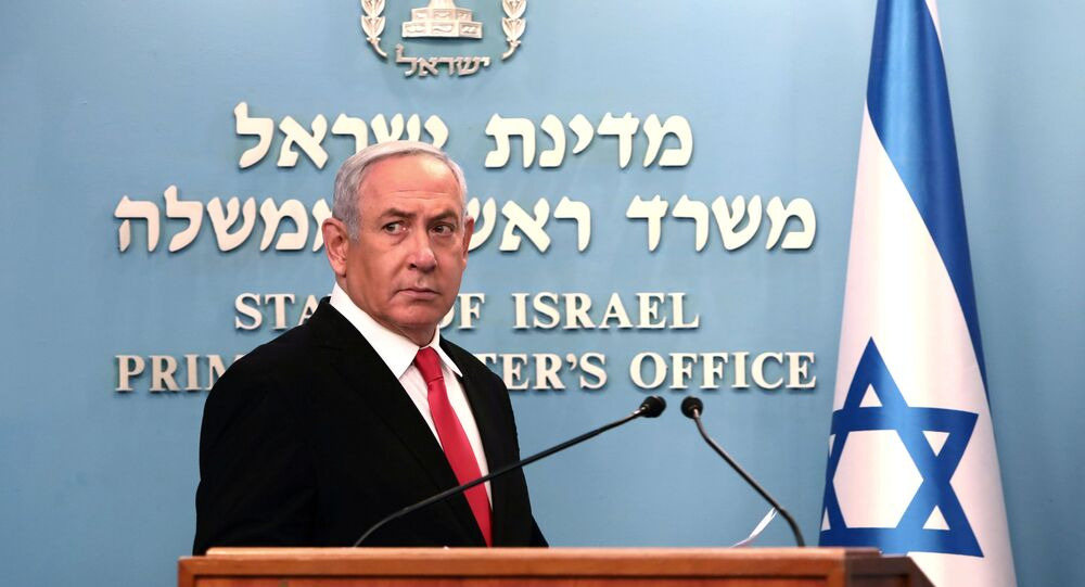 Israeli Prime Minister Benjamin Netanyahu delivers a speech at his Jerusalem office, regarding the new measures that will be taken to fight the coronavirus, March 14, 2020.