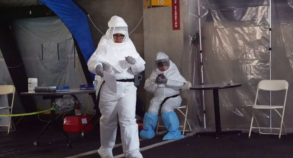 Medical personnel wear protective gear while working at a drive-through testing site for coronavirus disease (COVID-19) in Greenwich, Connecticut, U.S.,March 27, 2020