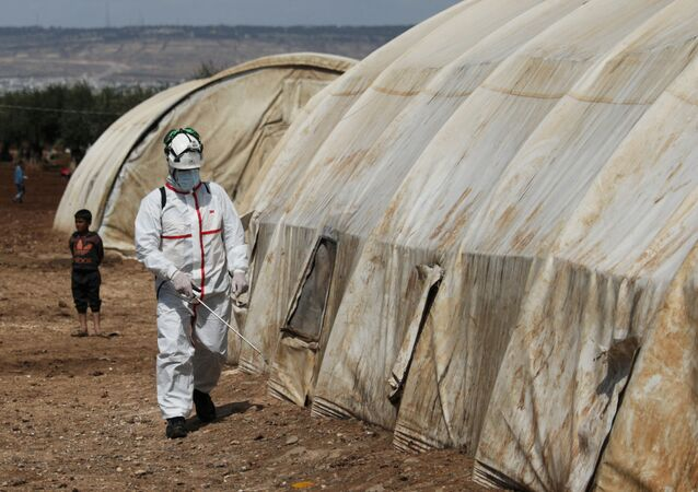 A member of the Syrian Civil defence sanitizes a tent at the Bab Al-Nour internally displaced persons camp, to prevent the spread of coronavirus disease (COVID-19) in Azaz, Syria 26 March 2020.