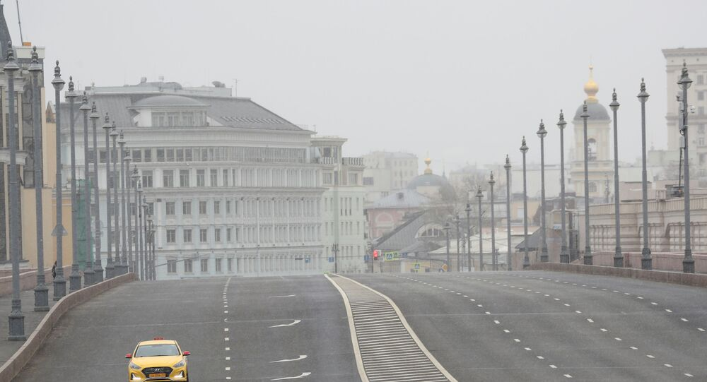 A car drives along a bridge across the Moskva River, after the city authorities announced a partial lockdown ordering residents to stay at home to prevent the spread of coronavirus disease (COVID-19), in central Moscow, Russia March 30, 2020