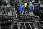 Workers wearing face masks are seen on a production line manufacturing parts for trailers to be exported to the U.S. at a factory, as the country is hit by an outbreak of the novel coronavirus disease (COVID-19), in Taizhou, Jiangsu province, China March 28, 2020. Picture taken March 28, 2020