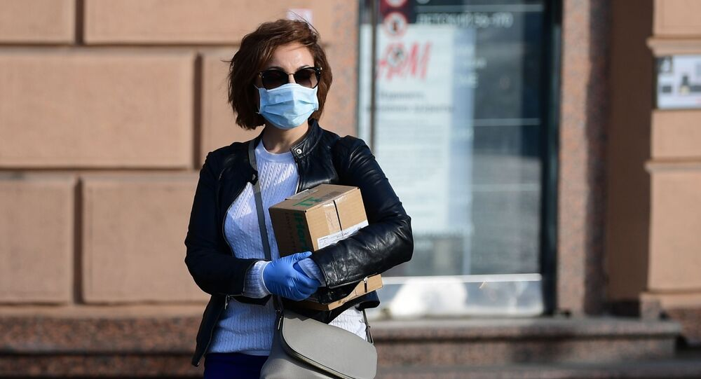 Girl in medical mask and gloves on Moscow Street