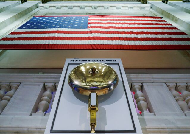 The bell used to open and close the markets hangs in front of an empty podium above the floor of the New York Stock Exchange (NYSE) as it prepares to close due to the coronavirus disease (COVID-19) outbreak in New York, U.S., 20 March 2020.