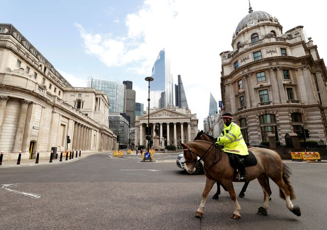 Police on horses patrol outside the Bank of England as the spread of the coronavirus disease (COVID-19) continues, London, Britain, March 31, 2020