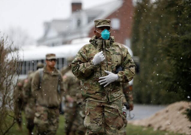 Members of Joint Task Force 2, composed of soldiers and airmen from the New York Army and Air National Guard, arrive to sanitize and disinfect the Young Israel of New Rochelle synagogue, as snow falls during the coronavirus disease (COVID-19) outbreak in New Rochelle, New York, U.S., March 23, 2020