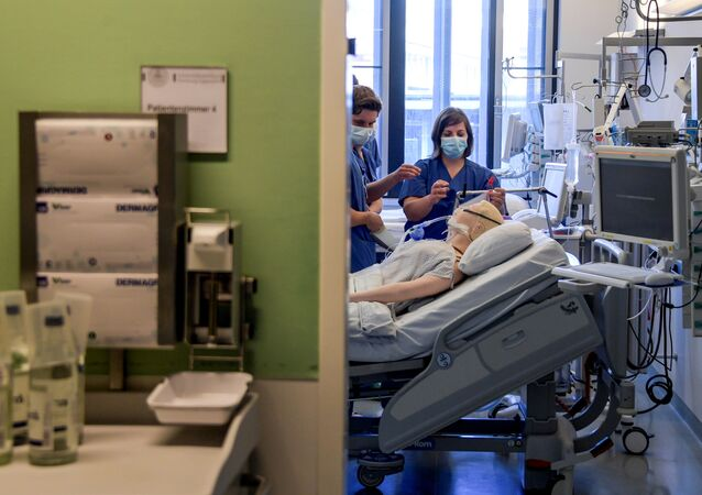 Doctors receive instructions for a respirator system at the intensive care unit of the University Medical Center Hamburg-Eppendorf in Hamburg, Germany, March 25, 2020, as the spread of the coronavirus disease (COVID-19) continues