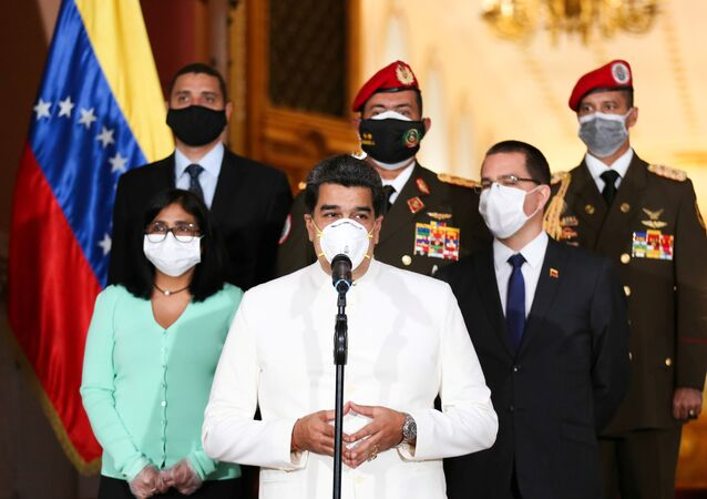 Venezuela's President Nicolas Maduro wearing a protective face mask makes a statement at Miraflores Palace in Caracas, Venezuela March 30, 2020