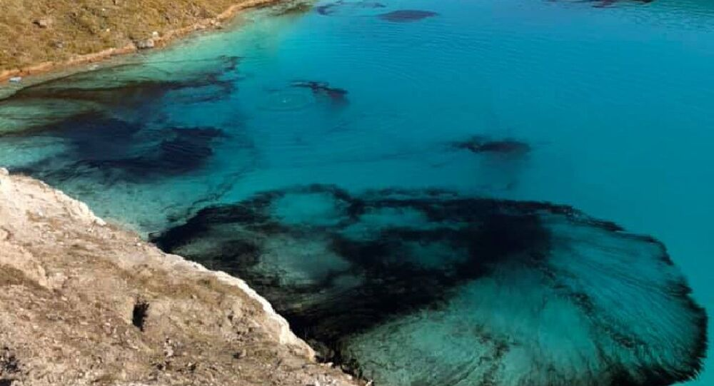 UK's Buxton Police dye town's Blue Lagoon' quarry lake black to deter visitors from visiting site amid COVID-19 lockdown measures.