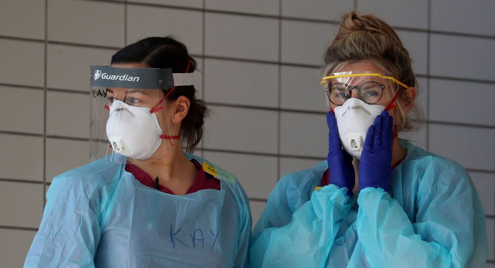 Medical staff wearing protective clothing at St Thomas' hospital as the spread of the coronavirus disease (COVID-19) continues, London, Britain, March 31, 2020.