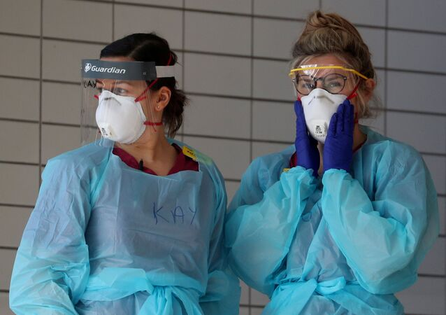 Medical staff wearing protective clothing at St Thomas' hospital as the spread of the coronavirus disease (COVID-19) continues, London, Britain, 31 March 2020.