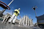 A worker wearing protective garments sanitises the Duomo square, during the coronavirus disease (COVID-19) outbreak in central Milan, Italy March 31, 2020