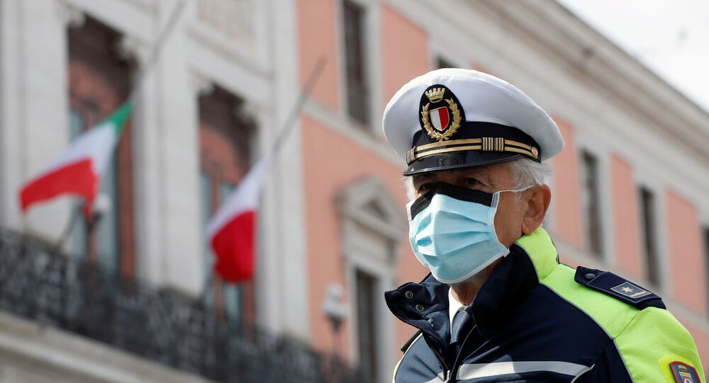 A police officer wears a protective mask, during the coronavirus disease (COVID-19) outbreak, in Bari, Italy, March 31, 2020