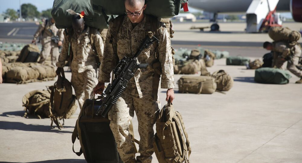 U.S. Marines and Sailors with Marine Rotational Force – Darwin 2018 collect their luggage and proceed to customs after arriving at the Royal Australian Air Force Base Darwin, Australia, April 17