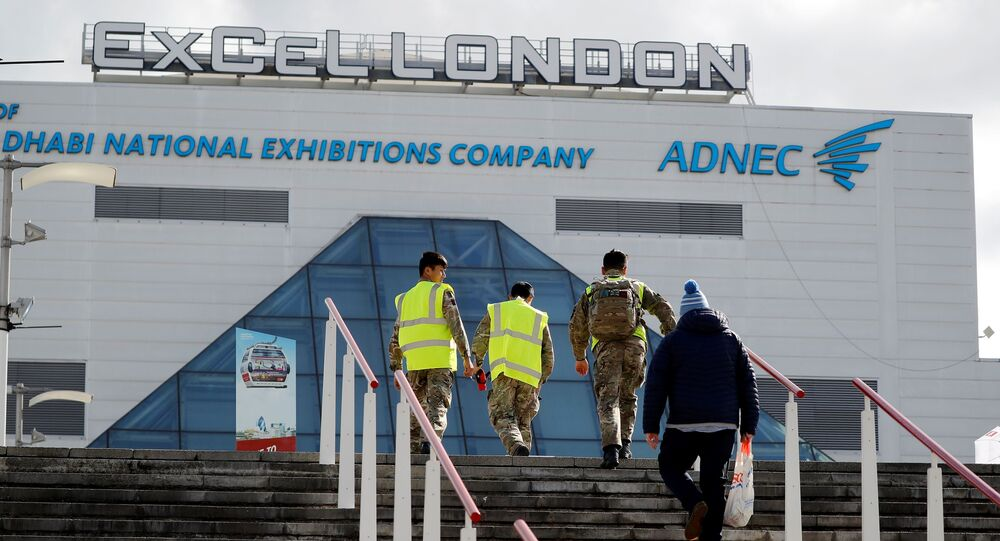 Members of Britain's armed forces arrive at the ExCeL London exhibition centre in London on March 31, 2020, where the NHS Nightingale field hospital has been created to help with the novel coronavirus COVID-19 pandemic.