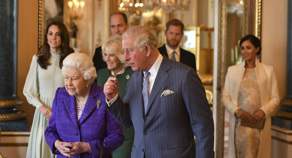 Queen Elizabeth II is joined by Prince Charles, the Prince of Wales, and behind from left, Kate, Duchess of Cambridge, Camilla, Duchess of Cornwall, Prince William, Prince Harry and Meghan, Duchess of Sussex during a reception at Buckingham Palace, London, Tuesday 5 March 2019, to mark the 50th anniversary of the Prince of Wales' investiture.