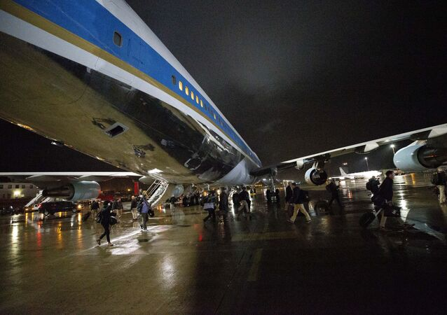 White House staff, U.S. Secret Service and the press pool swap planes to a waiting Air Force One, Friday, Nov. 29, 2019, at Ramstein Air Base, Germany