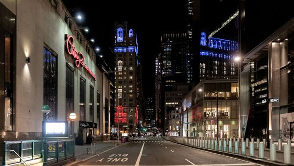 An empty street is seen near Wall street during the outbreak of the coronavirus disease (COVID-19) in Manhattan, New York City, U.S., March 27, 2020. Picture taken March 27, 2020 - Sputnik International