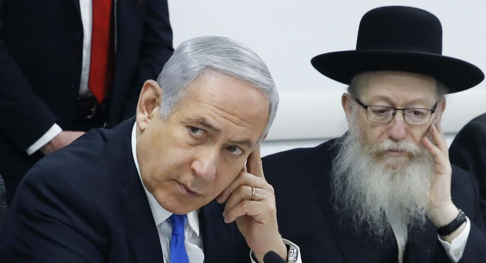 Israeli Prime Minister Benjamin Netanyahu, left, holds a situation assessment meeting with Health Minister Yaakov Litzman and others regarding the Coronavirus (COVID-2019), at the Health Ministry in Tel Aviv, Israel, Sunday, Feb. 23, 2020