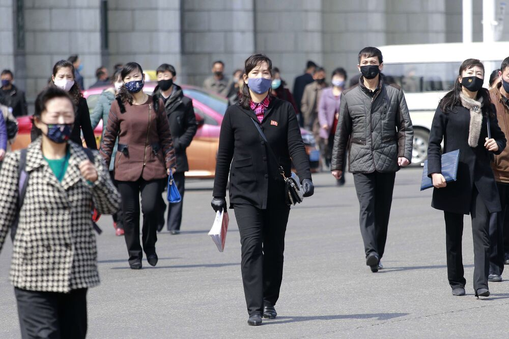 Pedestrians wear face masks to help prevent the spread of the coronavirus, Wednesday, 1 April 2020, in Pyongyang, North Korea.