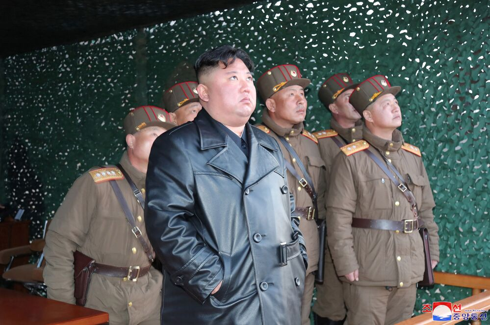 North Korean leader Kim Jong Un observes the firing of suspected missiles in this image released by North Korea's Korean Central News Agency (KCNA) on 22 March 2020.