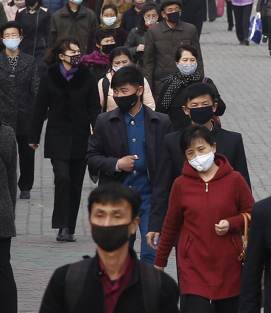 People wear face mask amid concerns over the spread of the coronavirus in Pyongyang, North Korea, Wednesday, 1 April 2020.