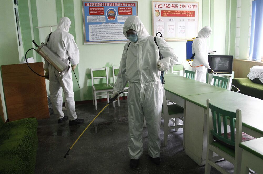 Offices at the Phyongchon District People's Hospital are disinfected, Wednesday, 1 April 2020, in Pyongyang, North Korea.
