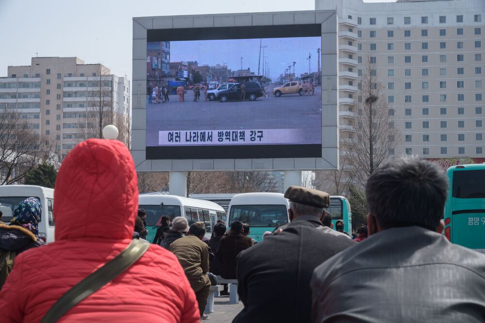 A news broadcast shows coverage relating to the COVID-19 coronavirus on a giant television screen near the central railway station in Pyongyang on 1 April 2020.