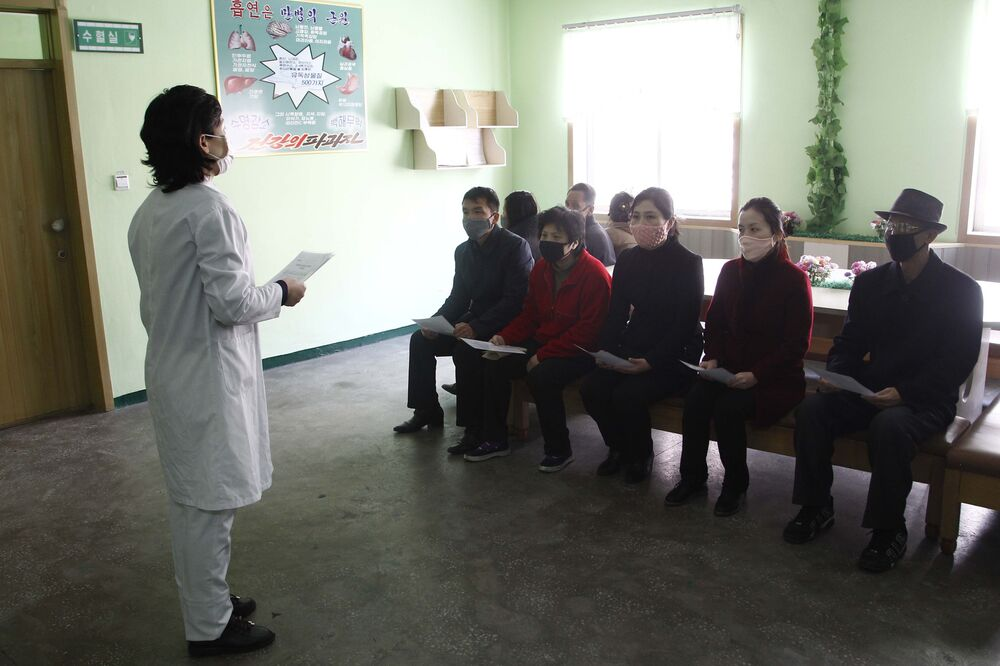 A nurse explains details about the COVID 19 and ways to prevent contracting it at the Phyongchon District People's Hospital Wednesday, 1 April 2020, Pyongyang, North Korea.