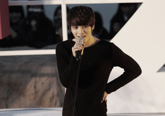 South Korean singer and actor Kim Jaejoong sings a song at the Open Talks to promote his movie Code Name: Jackal during the Busan International Film Festival in Busan, South Korea, Friday, Oct. 5, 2012.