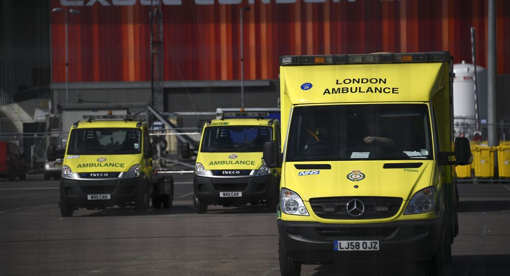 Ambulances at the ExCel Center in London, Thursday, April 2, 2020, that is being turned into a 4000 bed temporary hospital know as NHS Nightingale to help deal with some of the coronavirus outbreak victims in London. The new coronavirus causes mild or moderate symptoms for most people, but for some, especially older adults and people with existing health problems, it can cause more severe illness or death.