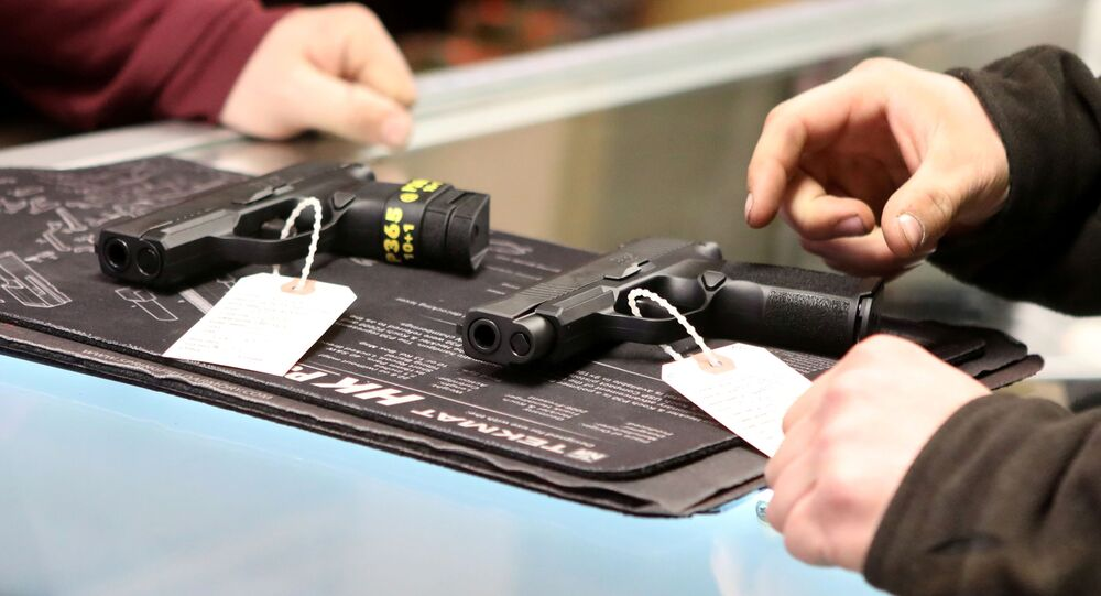A woman shops for a handgun at Frontier Arms & Supply gun shop in Cheyenne, Wyoming, U.S. March 18, 2020