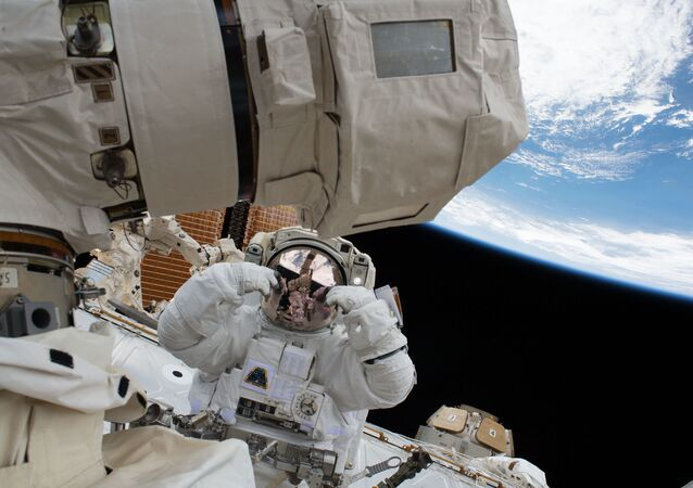 NASA astronaut Scott Tingle is pictured during a spacewalk to swap out a degraded robotic hand, or Latching End Effector, on the Canadarm2. NASA astronaut Mark Vande Hei also participated in the robotics maintenance spacewalk.