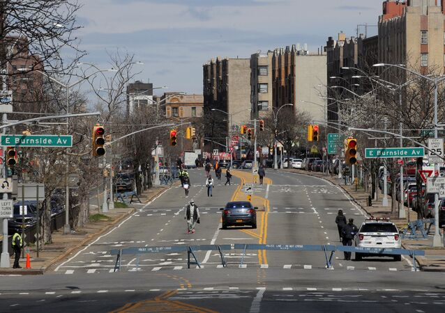 People walk on a temporarily closed section of the Grand Concourse during the outbreak of the coronavirus disease (COVID-19) in the Bronx borough of New York City, New York, U.S., April 2, 2020