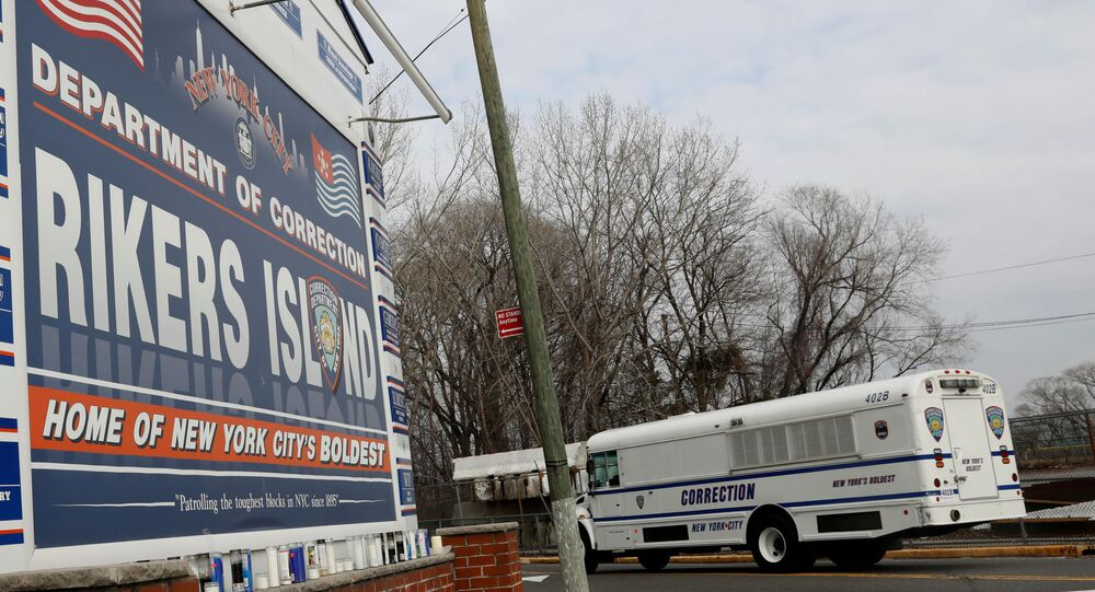 An NYC Department of Corrections vehicle drives in the entrance to Rikers Island facility in Queens, in New York, U.S., February 14, 2018