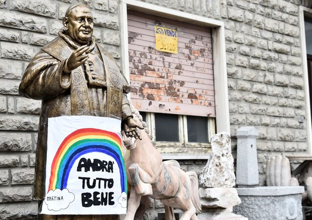 A sign reading Everything will be fine hangs on a statue of Pope John XXIII in Zogno near Bergamo, one of Italy's cities worst-hit by coronavirus disease (COVID-19), Italy March 22, 2020