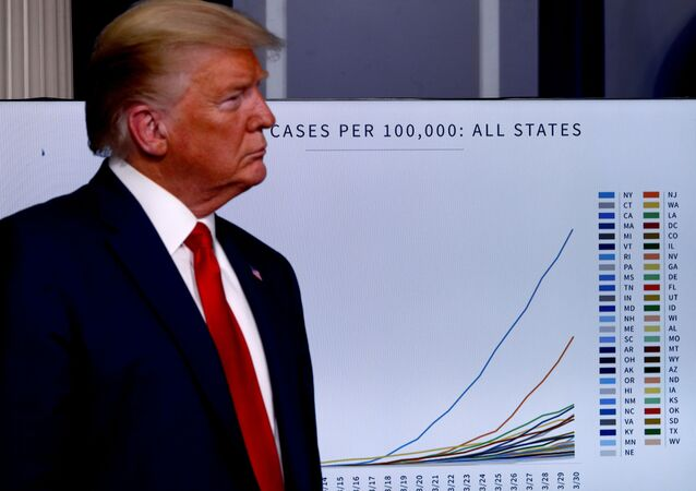 U.S. President Donald Trump stands in front of a chart tracking coronavirus cases in the United States as he faces the daily coronavirus response briefing at the White House in Washington, U.S., March 31, 2020.
