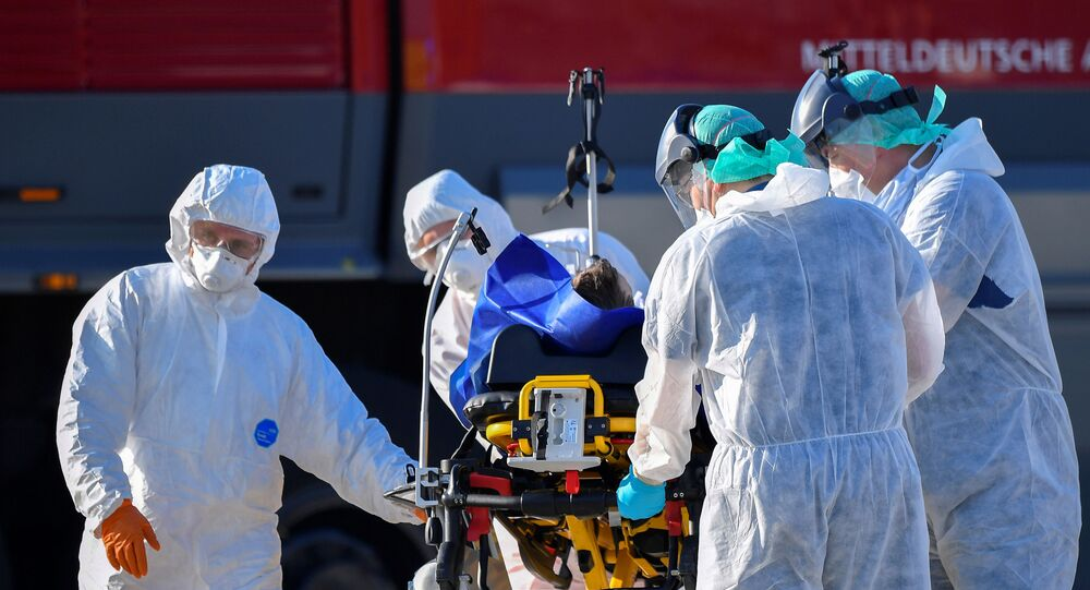 A coronavirus disease (COVID-19) infected patient from France is transferred from an ambulance aircraft to an ambulance car at the airport in Dresden, as the spread of the coronavirus disease (COVID-19) continues in Dresden, Germany April 2, 2020.