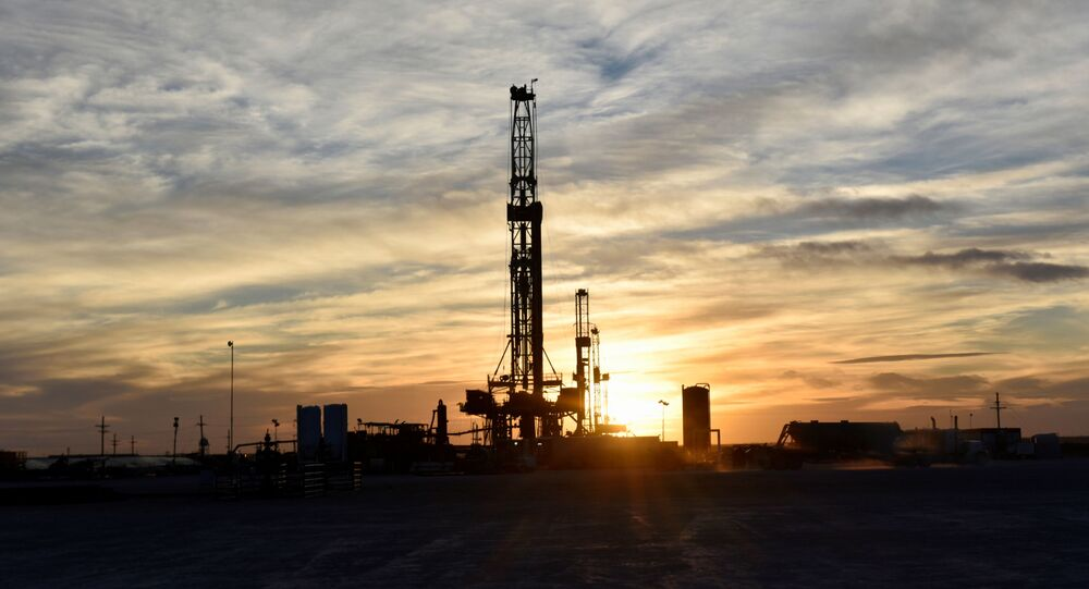 Drilling rigs operate at sunset in Midland, Texas, U.S., February 13, 2019