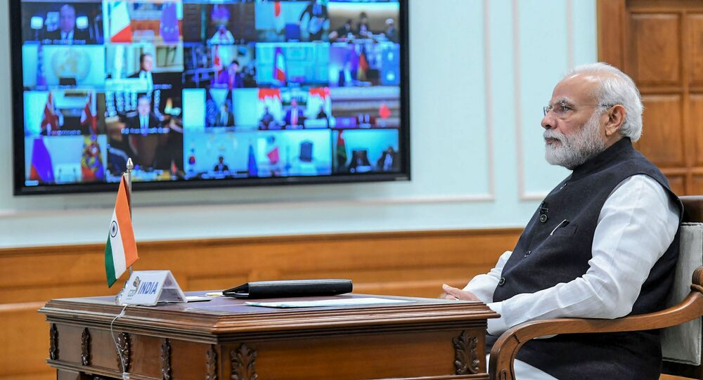 In this handout photo taken and released by Indian Press Information Bureau (PIB) on March 26, 2020, India's Prime Minister Narendra Modi attends a videoconference with G20 leaders to discuss the COVID-19 coronavirus, in New Delhi